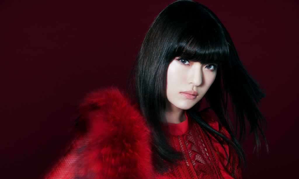 ASCA, dark red background, bright red clothes